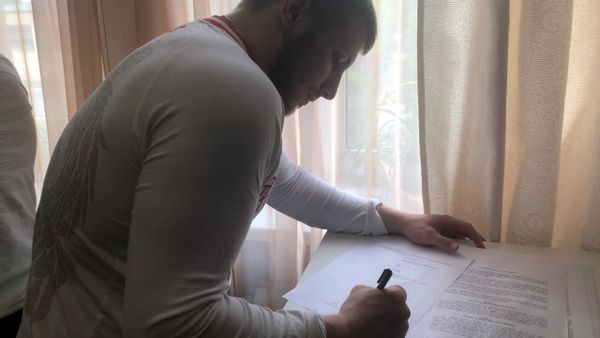 Vasily signing contract