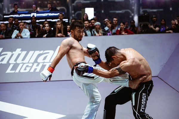 A Damaging Body Kick by Uzakov upon Ramirez in Karate Combat Season 3 Event 11