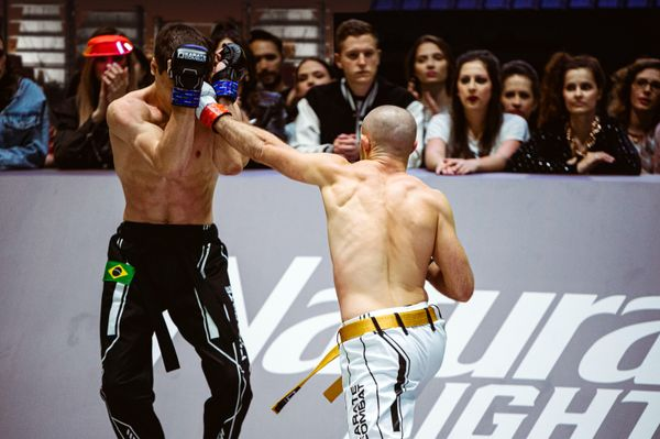 Lightweight Champion Edgars Skrivers delivers a blow to Bruno Assis in Event 7 of Karate Combat Season 3