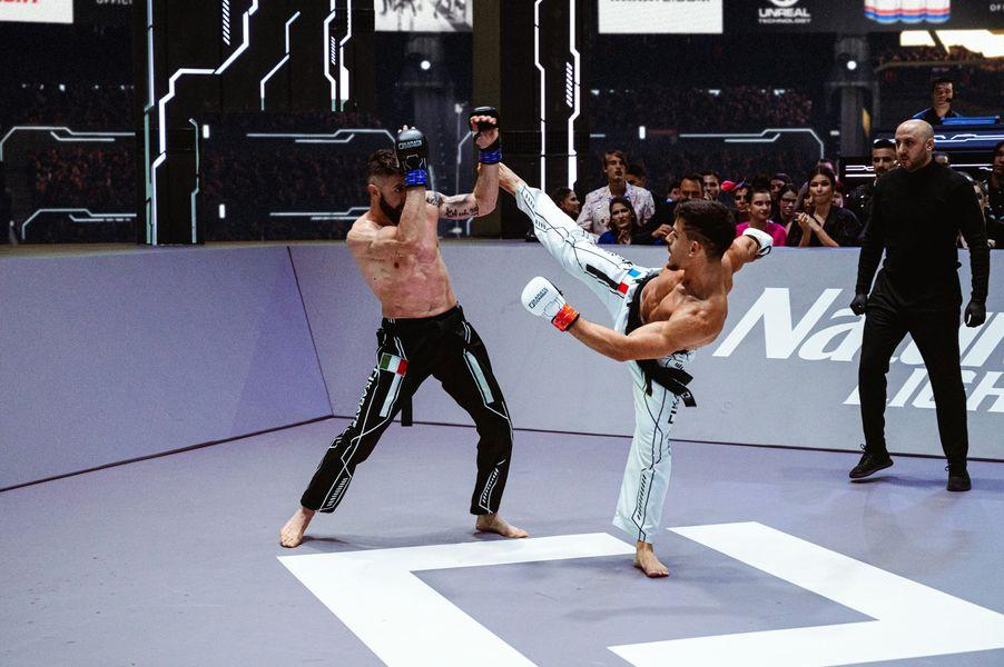 Gabriele Cera evades the head-kick by Alexandre Bouderbane